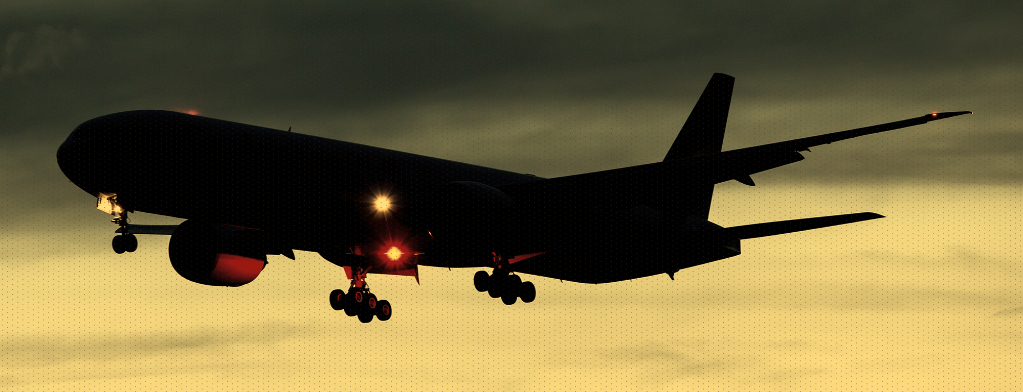 Airplane with landing gears down and lights on