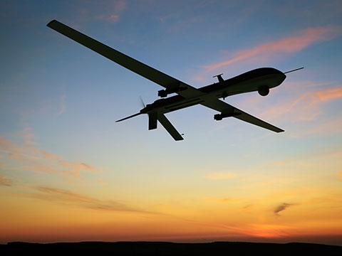 Drone flying across sky