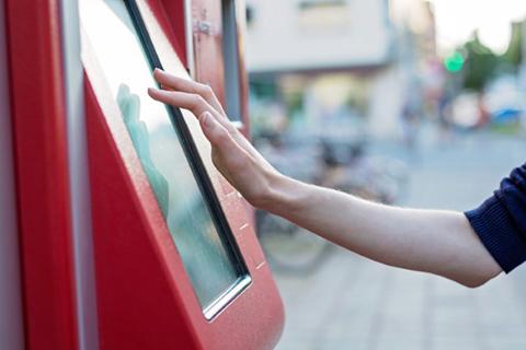 Human hand on kiosk screen