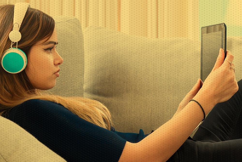 Young girl looking at tablet