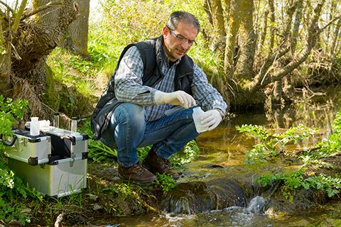 Man testing stream water