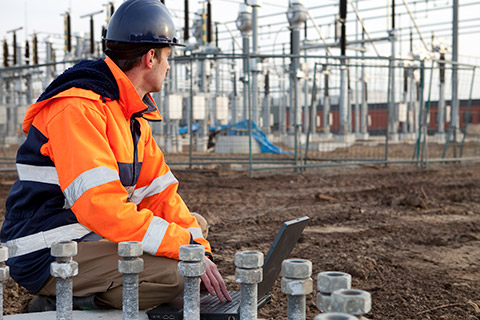 Electrician working on electrical grid
