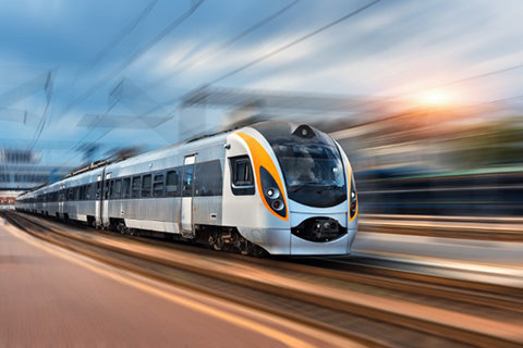 Train speeding down tracks